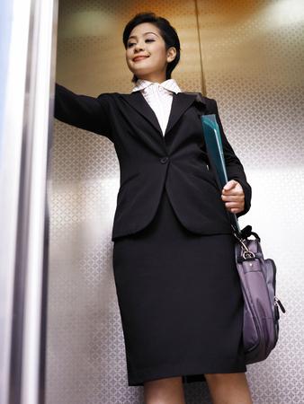 businesswoman in the elevator