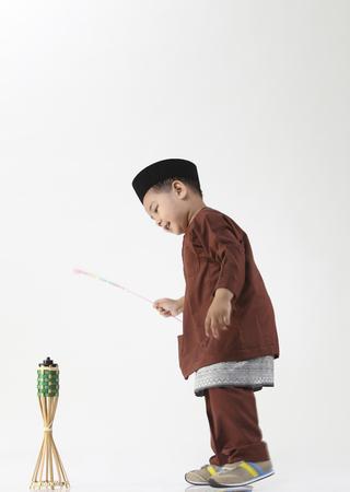 boy pretending playing firework and oil lamp Stok Fotoğraf