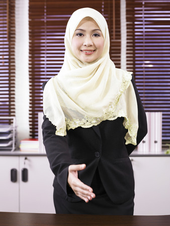 Businesswoman extending hand to shake