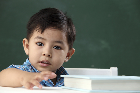 boy in the classroom looking at camera Standard-Bild