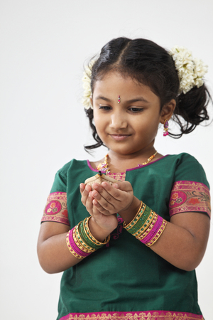 Little indian girl holding oil lamp