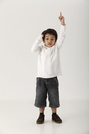 kid raising hiss arm on the white background