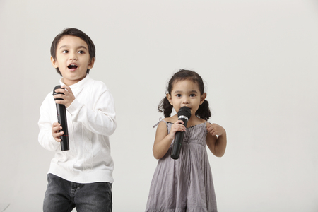 sister and brother sing together
