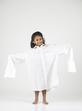 Little girl wearing oversized shirt