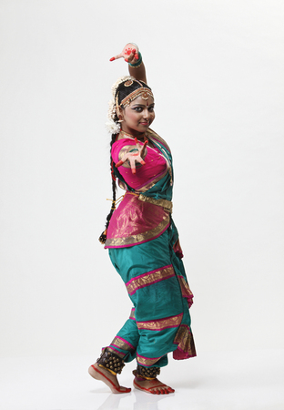 Indian dancer in traditional costume performing traditional dance Stock Photo
