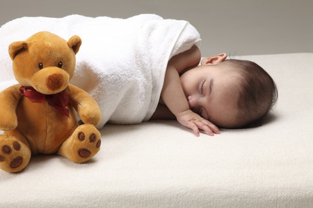 close up of Newborn and teddy bear Imagens