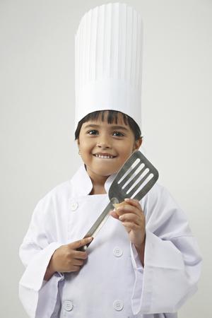Little girl in chef uniform Foto de archivo