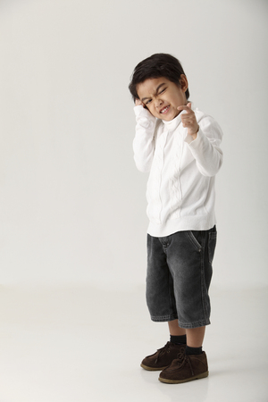 studio shot of kid on the white background