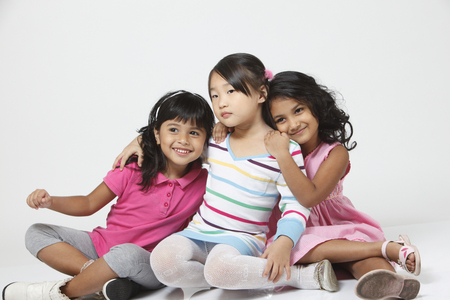 Portrait of three different races children