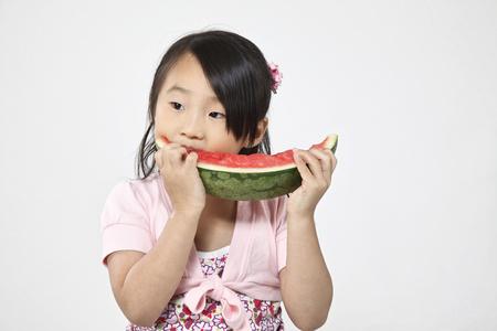Little girl enjoy eating watermelon