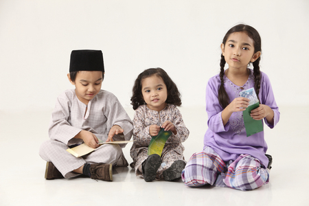 sisters and brother happy to receiving a green packet