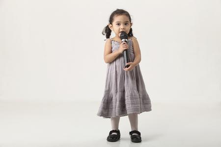 full length of the girl holding  microphone