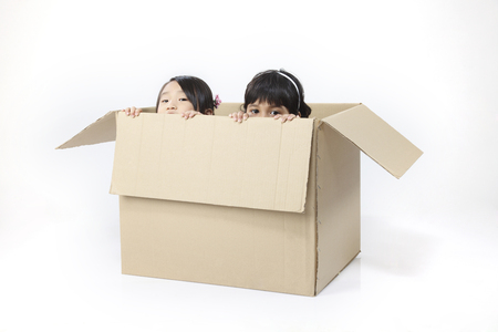 Two girls inside a box