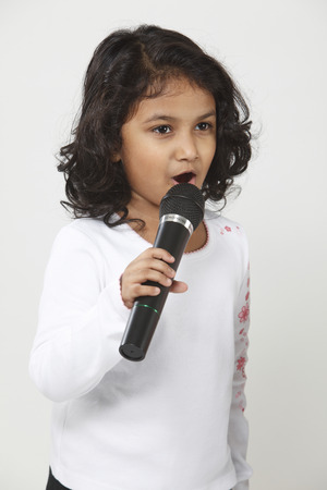 Close up of little girl singing
