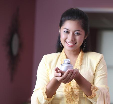 Malay girl holding oil lamp