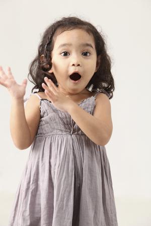 little girl shouting on the white background Imagens