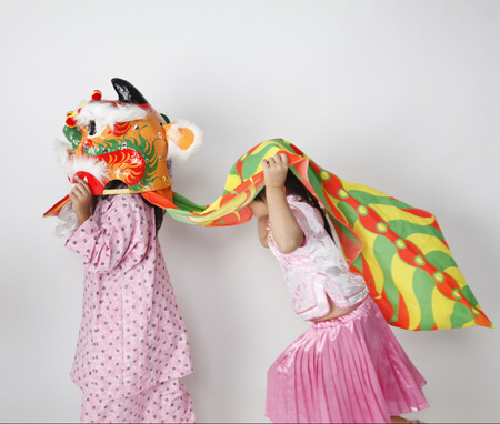 Two girls playing lion dance