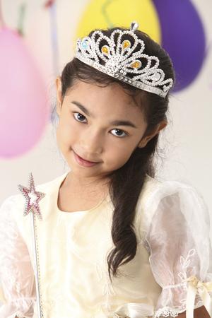 birthday girl holding a magic wand