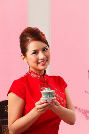 Young woman holding a tea cup Banco de Imagens
