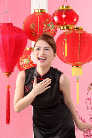young woman standing in front of red lanterns Banco de Imagens