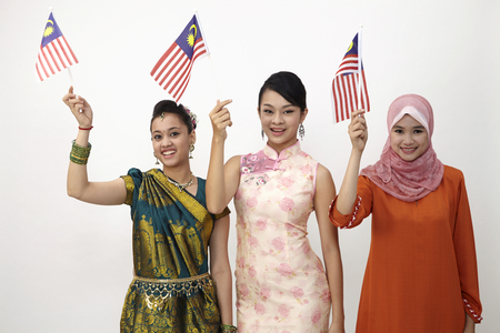 young women holding malaysia flag