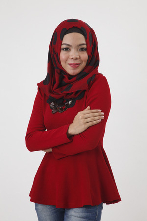 malay woman with red tudung cross arm