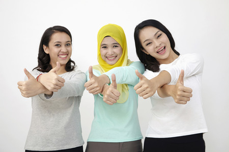 three Malaysian woman raising thumb 版權商用圖片