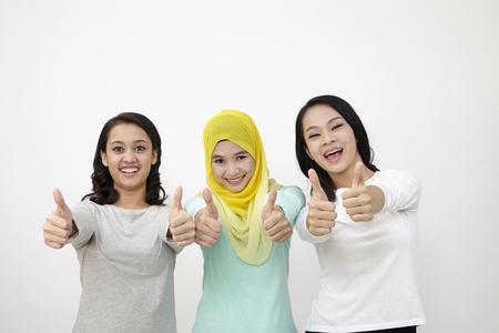 three Malaysian woman raising thumb Stock fotó