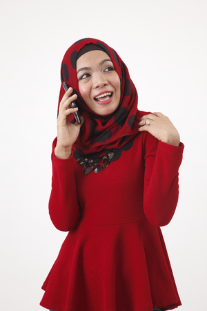 hijab with red tudung talking with mobile phone