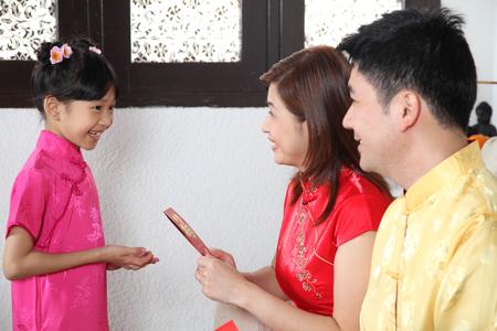 chinese family enjoying chinese new year Stock Photo