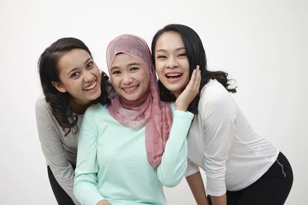 Harmony malaysian happy laughing at camera