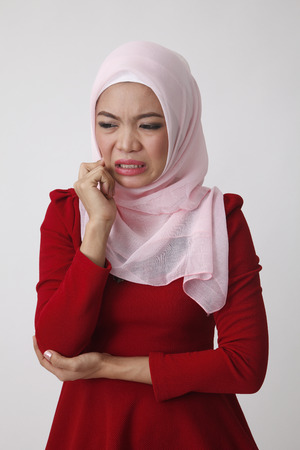 malay woman not feeling well Banco de Imagens