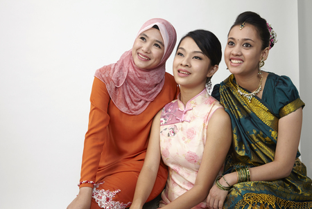 three malaysian sitting together with same vision