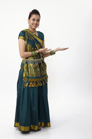 Indian woman wearing saree with hand gesture