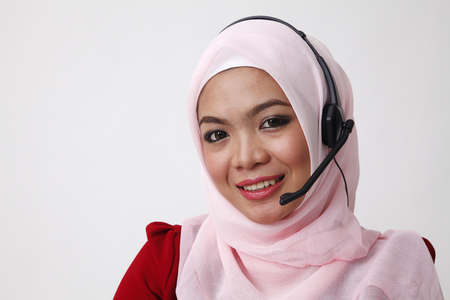 malay woman as receptionist looking at camera 免版税图像