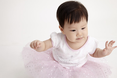 chinese baby  with party dress Imagens