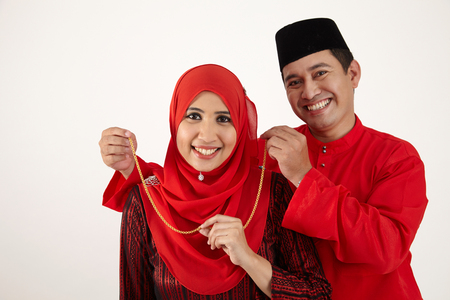 husband wearing a necklace for his wife at special occasion Stok Fotoğraf