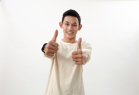 malay boy raising his arm with thumb's up Banco de Imagens
