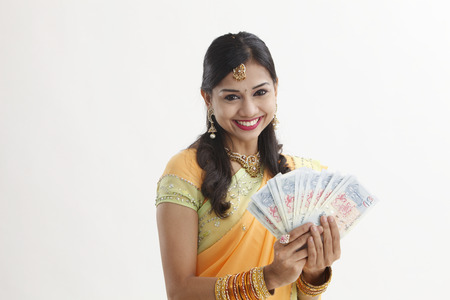 inadin woman in saree holding Singapore cash notes Stock Photo
