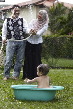 parent splashing water to their children