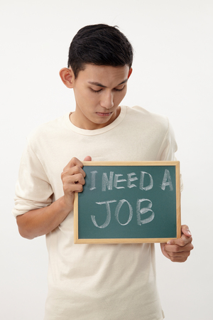 malay teenage holding a message that his need jobs