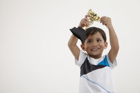 malay boy holding a trophy Standard-Bild