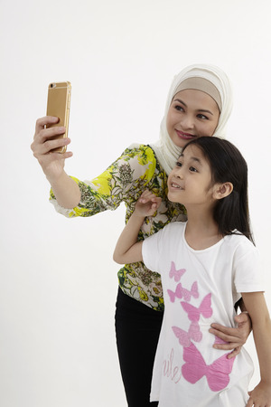 mother and daughter taking picture together