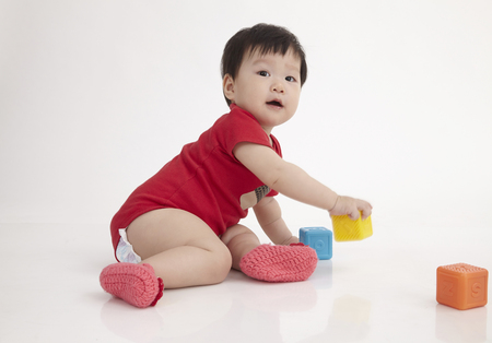 chinese baby  playing with alphabet block
