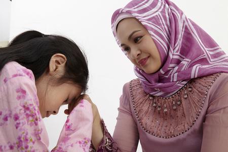 Young Muslim women greeting to elders