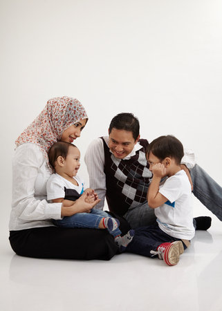 family playing together on the white background