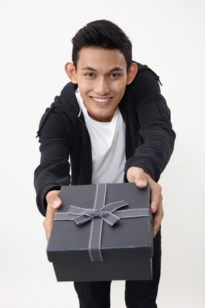 man holding an exclusive present 스톡 콘텐츠