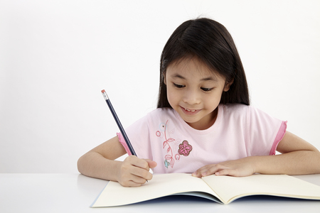 little girl writting doing homework
