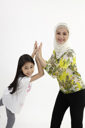 give me five ,mother and daughter Stock Photo
