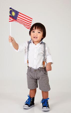 말레이시아 국기를 들고 중국 소년 스톡 콘텐츠